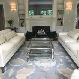 Elegant Living Room with glass coffee table, floral rug