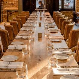 custom 30' white oak dining table at Ledger in Salem, MA