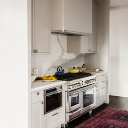 San Francisco Residence, Kitchen with marble backsplash and vintage rug