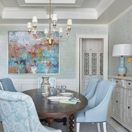 Pastel contemporary dining room with an antique mirror and traditional elements.