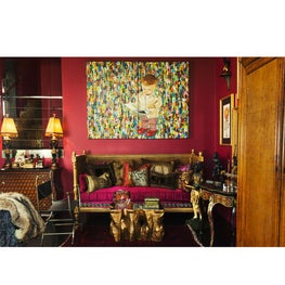 Seating area with over-sized oil painting and antique French daybed and pillows