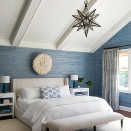 Serene master bedroom in classic Hampton's weekend home