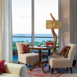 An intimate sitting area by the balcony is a combination of the old and the new.