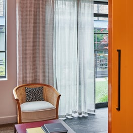 West London Design Studio, bright orange reception room