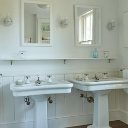 Pair of pedestal sinks in guest bathroom.