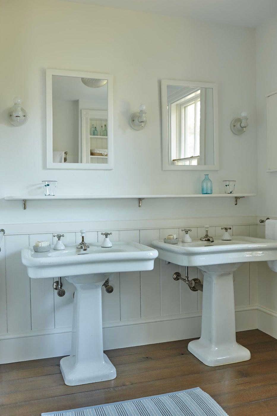 Pair of pedestal sinks in guest bathroom.