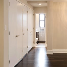 Modern Glam Apartment Renovation - Hallway with Custom Closet