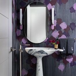 Striking Powder Bath Featuring Hand Painted Wallpaper