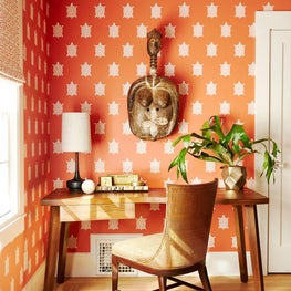 Office - mid century modern furniture with African artifacts and turtle patterned wallpaper