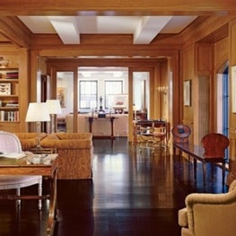 Fifth Avenue living room with wood walls and ceiling beams