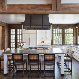 Weathered timber beams and columns envelope modern lodge kitchen