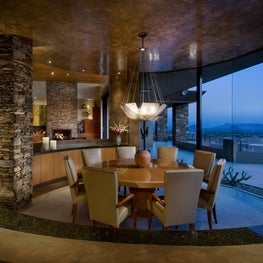 Arizona dining room with round Dakota Jackson table and leather chairs.