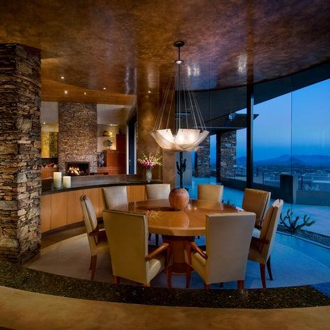 Arizona dining room with round Dakota Jackson table and leather chairs.