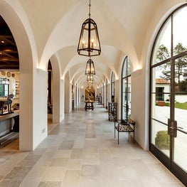 Spanish Colonial Equestrian Estate, limestone hallway with symmetrical arches