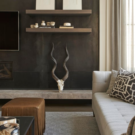 Ukrainian Village townhouse living room with dramatic, metal accent wall.
