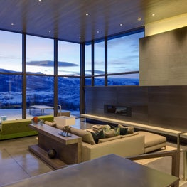 Starwood Aspen- Living Room- Fireplace, Stone and Steel clad wall, European furniture