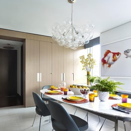 Eat in kitchen with clean and cheerful surfaces and modern furniture.