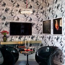 Brett Design oversized floral Tulips Wallpaper in glamorous black & white room.