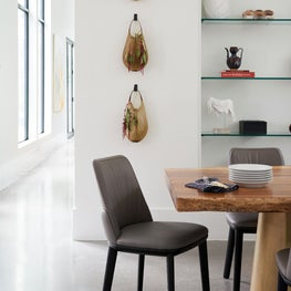 Modern dining room with hanging planters and custom table
