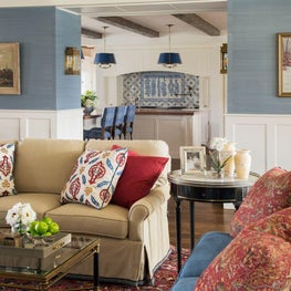 Warm colorful modern farmhouse living room with wainscoting