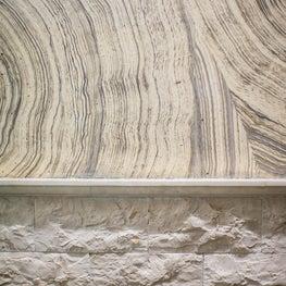 Coastal Modern Bathroom featuring stone texture