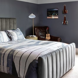 Striking bedroom with grey accent walls
