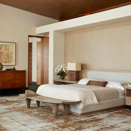 Malibu Master Bedroom with handcrafted wallpaper and antique rug