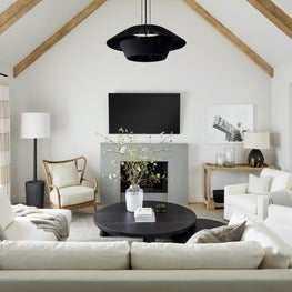 Pebble Beach living room with neutral tones, dark accents and bright art.