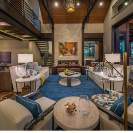 Foyer, great room, and outdoor patio set up at Martis Camp residence