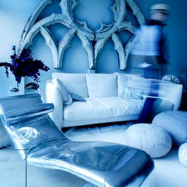 Cool blues by the Highline / An old gothic window from a church hangs over this sexy lounge with a futuristic silver chaise lounge