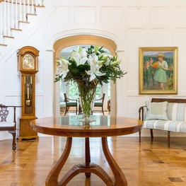 New Canaan, Ct Grand Entrance with Elegant Wood Paneling, Sweeping Staircase, Parquet Flooring, Crystal Chandelier, Mahogany Center Hall Table