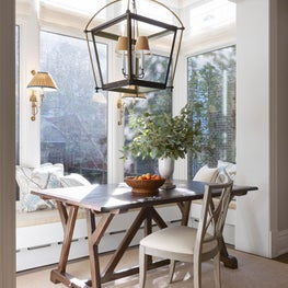 Cozy breakfast nook with custom bench and zinc table.