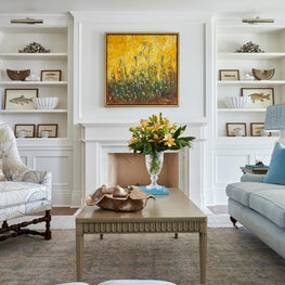 A contemporary living room with traditional elements with a soft color palette.