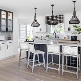 Crisp and simple white kitchen, with mix of patterns and textures