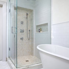 Master ensuite. Mother of pearl mosaics in the shower. Shades of white.
