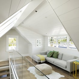 Converted attic becomes a light-filled lounge thanks to the added dormer windows