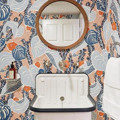 Bohemian Chic Powder Room with Foliage Wallpaper
