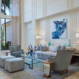 Palm Beach Serenity - Living Room using blues with large artwork and custom luxury fabrics.