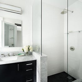 Upper East Side Master Bathroom with Black & White Accents and Custom Vanity