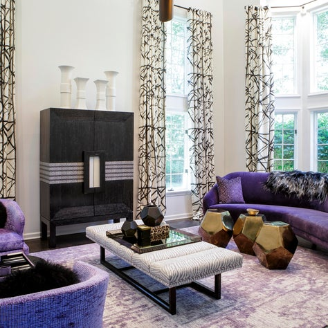 Living space fit for a King & Queen. Purple contrast against the lighter colors.