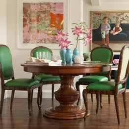 Dining Room table and leather upholstered chairs are beautiful and functional