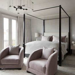 16th Ave Master Bedroom with four poster bed, modern seating, calming palette