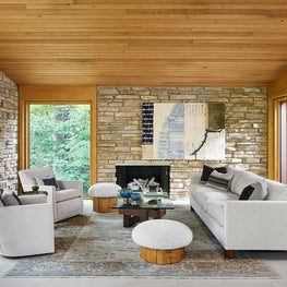 Treehouse Above The Lake | Bright and Neutral Living Space with Stone Walls