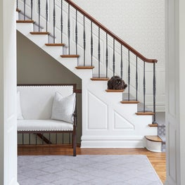 Glencoe entry foyer with custom bench, gray runner, patterned wallpaper