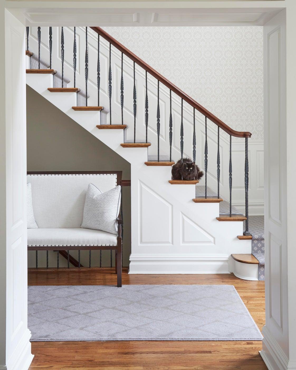 Glencoe entry foyer with custom bench, gray runner, patterned wallpaper
