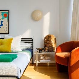 Mies : Rust Chair, Vintage Rug, Metal Bed, Sconce, Art, Wood Side Table