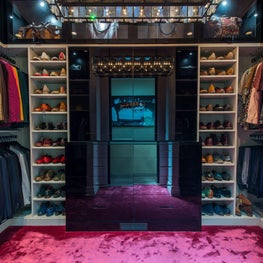 Custom Closet with silk carpet, lacquer hutch, & faux leather shelves