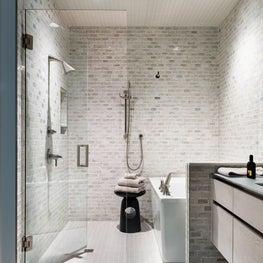 Sleek Principal Bath with Tiled Shower Walls