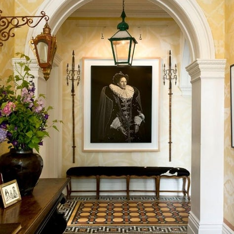 Entrance hall to a town house in London, with a drag queen dressed as a queen greeting you!