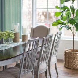 Bright breakfast room with floor-to-ceiling windows